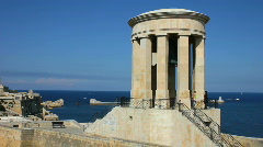 Siege Bell Memorial high above the entrance to the Grand Harbour Valetta Stock Footage