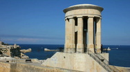 Stock Video Footage of Siege Bell Memorial high above the entrance to the Grand Harbour Valetta
