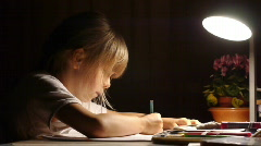 Stock video footage school girl doing homework - stock footage