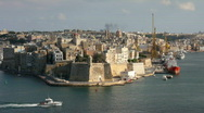 Stock Video Footage of A boat passes Senglea to enter the Grand Harbour Valetta