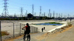 Kids on Bikes Enter San Gabriel River Basin Stock Footage