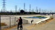 Stock Video Footage of Kids on Bikes Enter San Gabriel River Basin