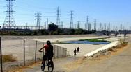 Kids on Bikes Enter San Gabriel River Basin Stock Footage
