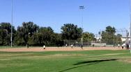 Playing Baseball At City Park Stock Footage