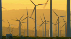 Wind turbines sunrise pan Stock Footage
