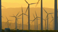 Stock Video Footage of wind turbines sunrise pan