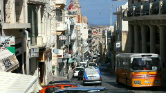 Stock Video Footage of Buses and cars on the steep narrow road through Mellieha Malta