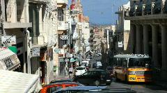 Buses and cars on the steep narrow road through Mellieha Malta - stock footage