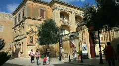 Tourists outside the courtyard of the National Museum of Natural History Mdina Stock Footage