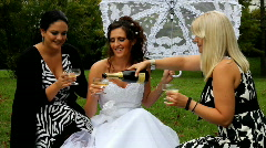 Bride and her friends champagne toast Stock Footage