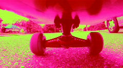 Dayglo Skateboard. Starting and stopping. Stock Footage