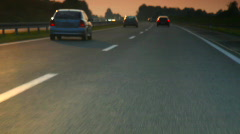 Car driving on highway in sunset Stock Footage