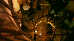 People ascending narrow spiral staircase in old building Stock Footage