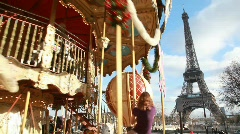 carousel in paris, eiffel tower in background, Paris, France. - stock footage