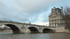 View from boat moving on Seine river near by bridge Pont Royal and Louvre, Paris Stock Footage