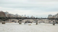 View from cutter moving in Siene river past by bridge Pont des Arts, Paris, Stock Footage