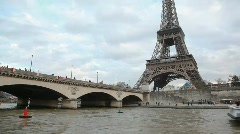 Eiffel Tower and bridge over the Seine river, Paris, France. Stock Footage