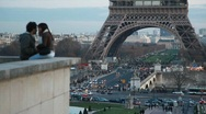 Stock Video Footage of defocused couple in evening Paris, Eiffel Tower in background, Paris, France.