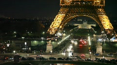 Cars on crossroad under night Eiffel Tower with illumination, Paris, France. Stock Footage
