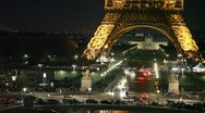 Stock Video Footage of cars on crossroad under night Eiffel Tower with illumination, Paris, France.