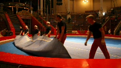 Workers rolling up mat surface of arena in the Old Nikulin Circus, Moscow, Stock Footage