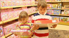 Boy and girl selecting puzzles Stock Footage