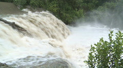 Waterfall in flood with dirty brown water Stock Footage