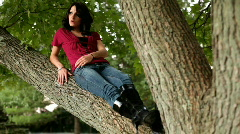 Girl laying on Tree Branch Stock Footage