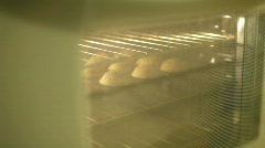 Taking Muffins out of oven ambient light Stock Footage