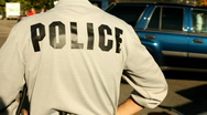 Police Officer standing near traffic Stock Footage