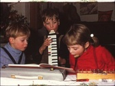 Stock Video Footage of Children playing instruments (vintage 8 mm amateur film)
