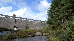 Clatteringshaws Hydroelectric Dam Wall, Galloway Forest Park, Scotland, UK Stock Footage