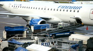 Loading luggage on to aircraft Stock Footage