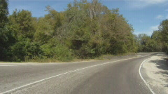 Driving along scenic mountain road Stock Footage