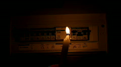 Searching for Faulty Circuit Breaker with Candle - stock footage