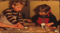 Boy nibbling while making Cristmas cookies (vintage 8 mm amateur film) Stock Footage