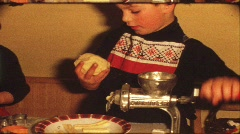 Children making Cristmas cookies (vintage 8 mm amateur film) Stock Footage