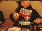 Stock Video Footage of Children making Cristmas cookies (vintage 8 mm amateur film)