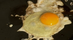 Egg frying Stock Footage