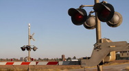 Train Passing through Railroad Crossing Stock Footage