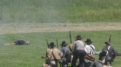 Huddled Group of Confederate Soldiers, Firing on Unseen Enemy Stock Footage