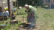 Woman Cooking over Open Fire in Civil War Setting Stock Footage