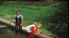 Children making fitness exercises (vintage 8 mm amateur film) Stock Footage