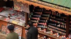 Russian souvenir, Matryoshka shop in Izmailovo flea market in Moscow Stock Footage