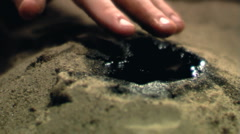 Oil in the hands - stock footage