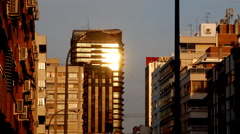 Sun refecting on buildings Stock Footage
