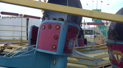 Find your seat on the Tilt-a-Whirl Stock Footage