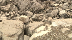 Frank Slide Rocky Ground tilt up shows Devastated Moonscape of Tumbled Stones Stock Footage