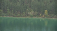 Kalamalka Lake reflects Emerald Green in rugged Wilderness Setting Stock Footage