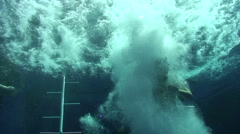 Scuba Diver entering the water from boat Stock Footage